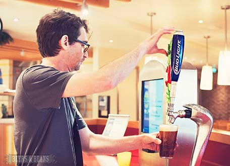 Randy pouring himself a beer at one of the beer stations on the Lido deck