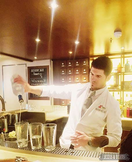 One of Vista's mixologists at the Alchemy Bar making some drinks