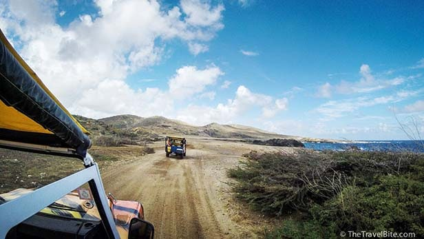 Riding down a dirt road in Aruba on the North Coast Jeep Safari
