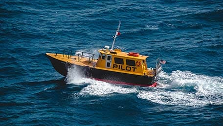 Yellow pilot boat in the ocean