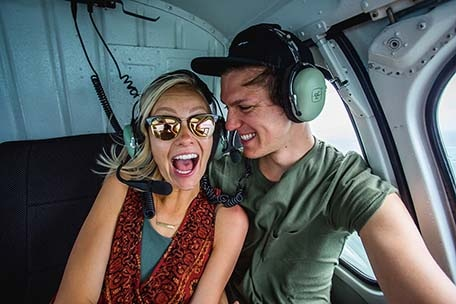 Brad and Hailey enjoying their helicopter ride in Grand Cayman