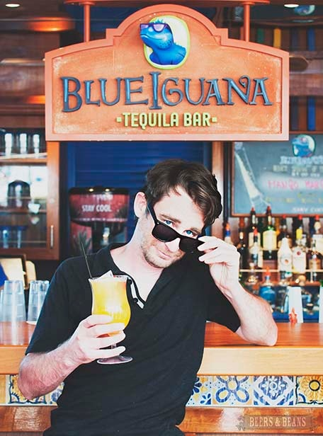 Randy sitting at the BlueIguana Tequila Bar holding a cocktail