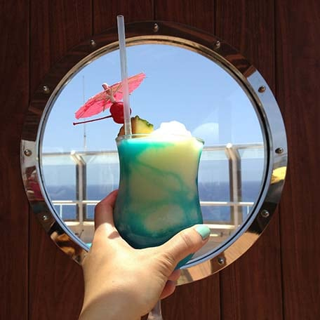 cocktail drink in front of port hole