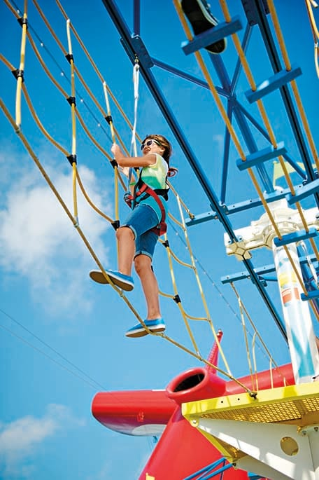 young girl climbing the ropes course at skycourse in sportsquare