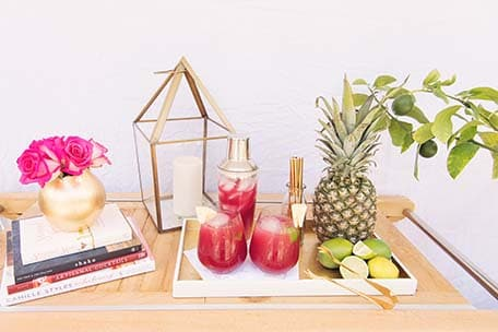 Sea breeze cocktail, fruits and flowers displayed on a wooden table