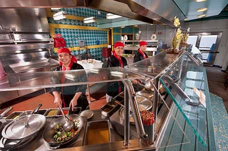 chefs cooking dishes onboard at mongolian wok