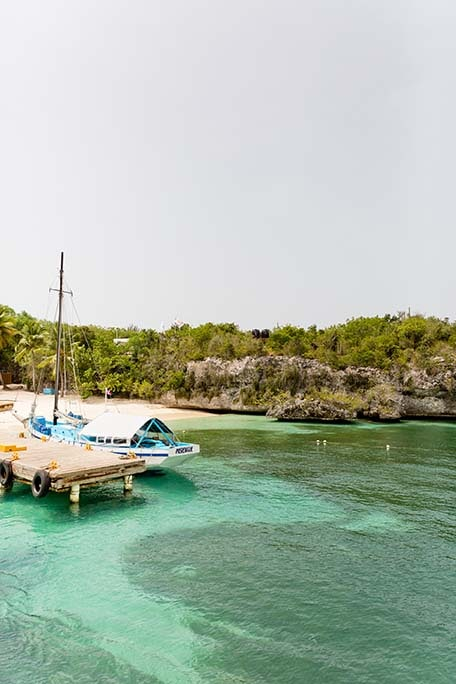 View from the water of a dock and the beach on Catalina Island, Dominican Republic