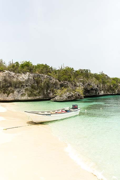 White boat anchored on the beach