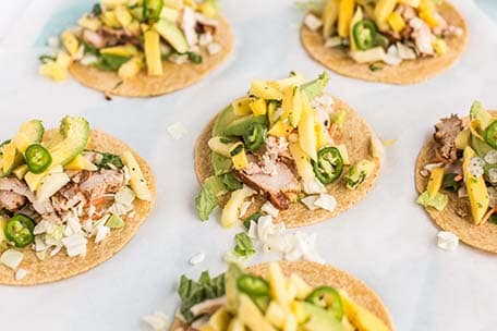 Display of several pineapple mango chicken tacos