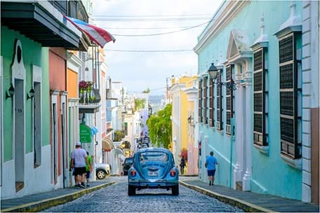 Car driving down a street in Old San Juan, Puerto Rico