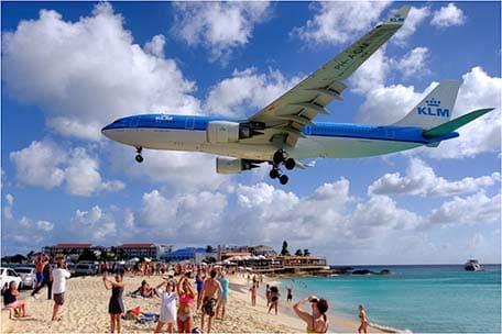 Plane flying overhead Maho Beach in St. Maarten