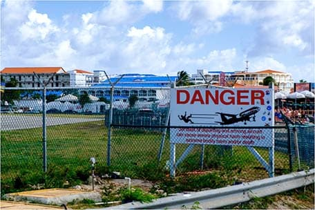 Danger sign at Maho beach for planes flying overhead