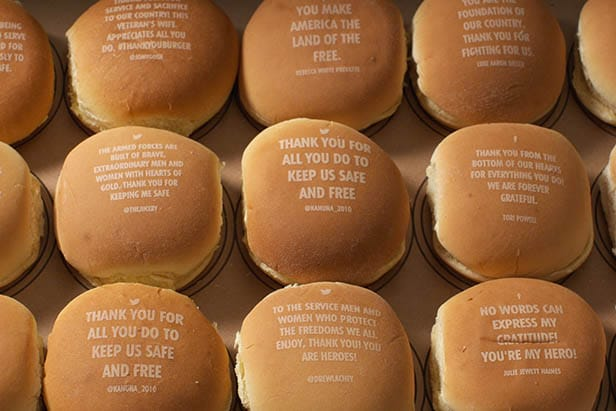 a group of burgers with gratitude messages lasered onto the buns