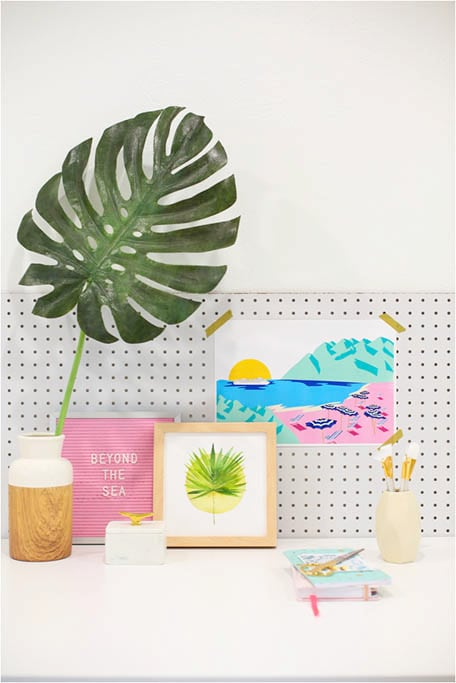 Desk with colorful accessories and illustration of Italian coastline