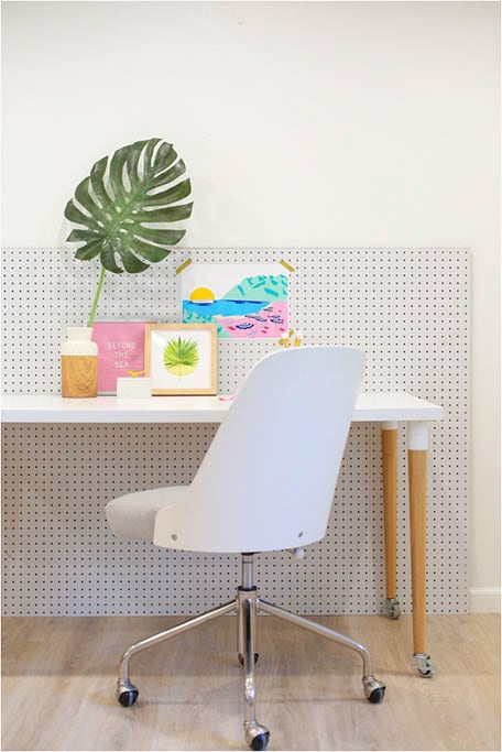 White chair and desk with colorful decorations