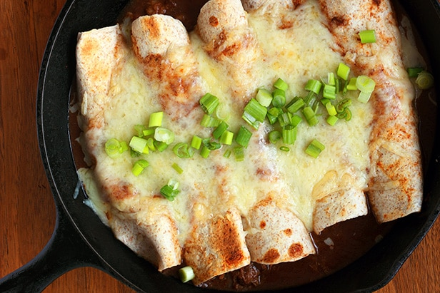 enchiladas in a cast iron pan