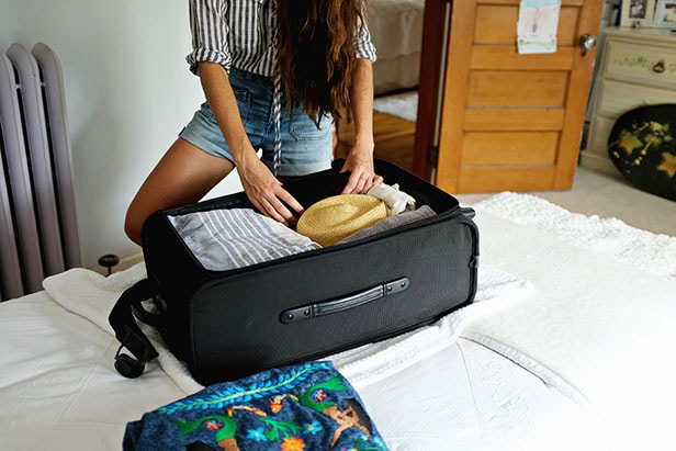 Andrea finishing up packing her suitcase