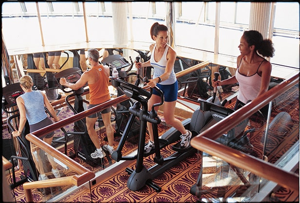 guests working out at the onboard fitness center