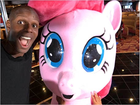 Doyin posing with Pinkie Pie from My Little Pony on Carnival Imagination