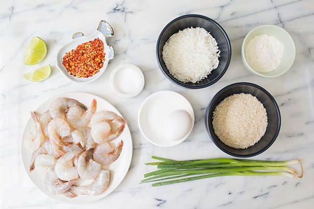 Overhead photo of coconut shrimp ingredients displayed on a kitchen counter