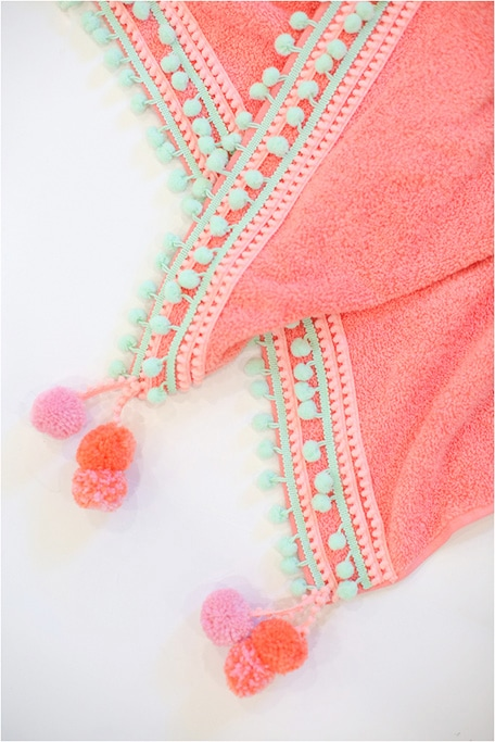 Close up photo of DIY pompom beach towel