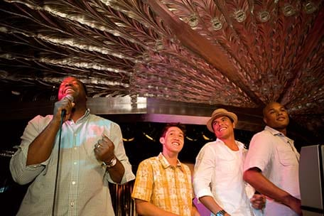 group of friends singing karaoke