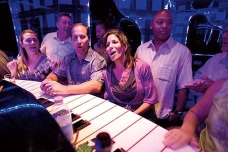 group singing at the piano bar