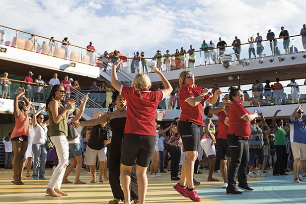 crew and guests dance during sailaway party