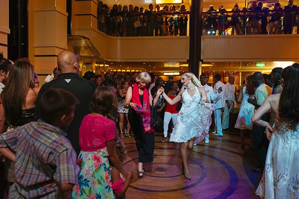 guests dancing at atrium with professional dancers