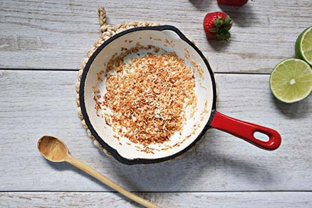 Toasted coconut in a skillet