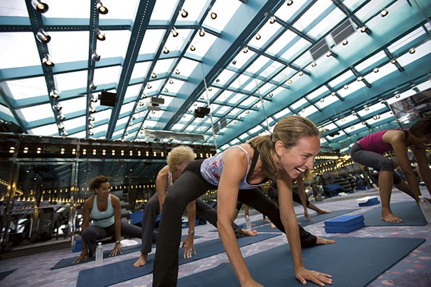 women in a yoga class on a carnival cruise