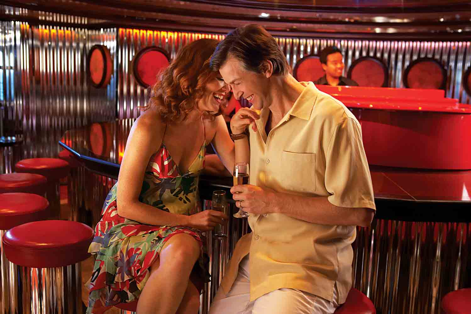 couple at piano bar on a carnival ship