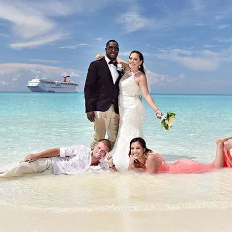 a couple posing on a beach for their wedding