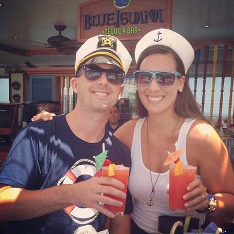 a couple with drinks at blueiguana tequila bar