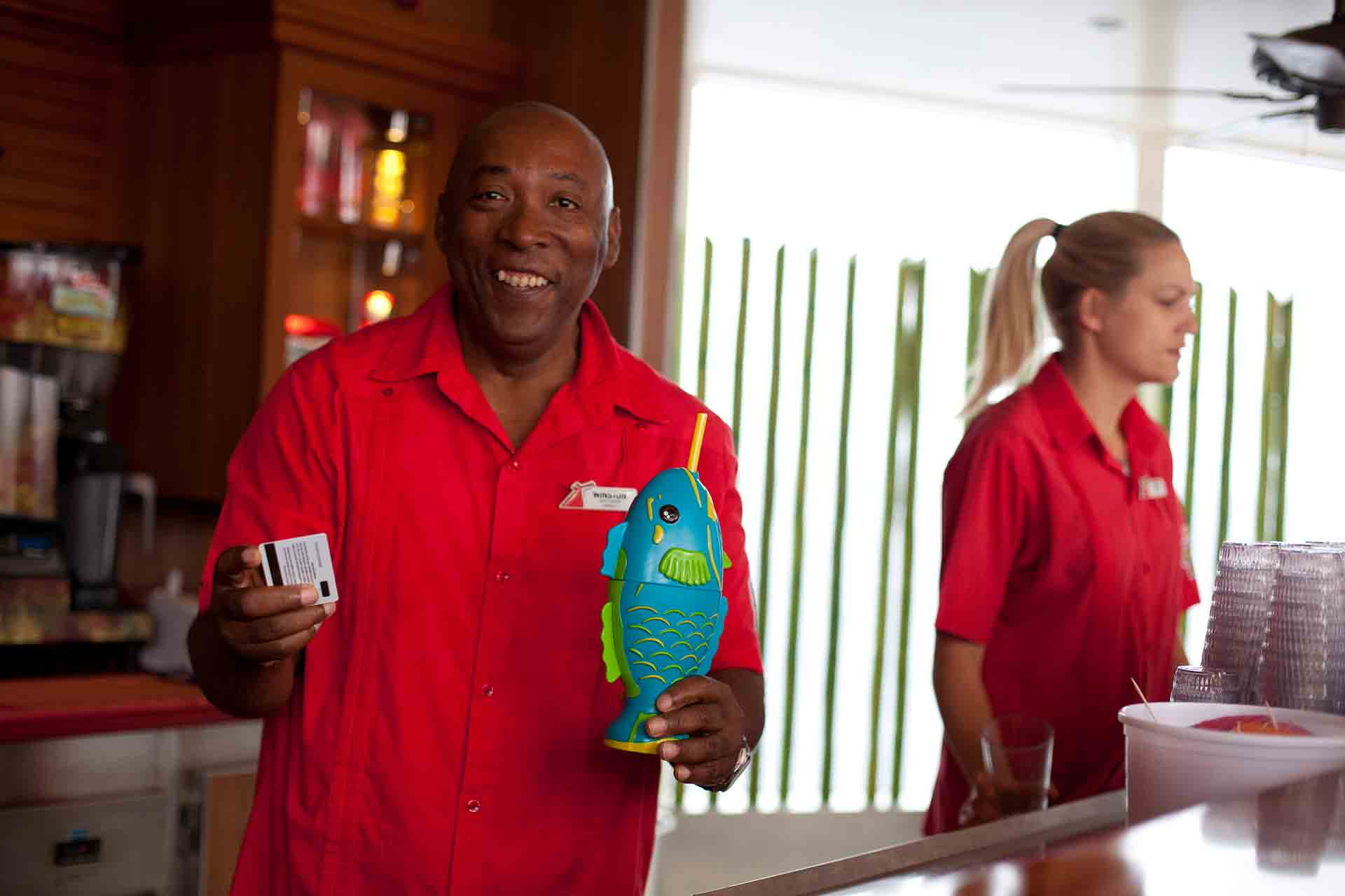 crew member serving a drink onboard