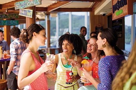 group of women at bar with drinks