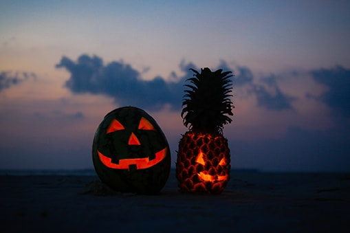 halloween fruit lanterns on the beach