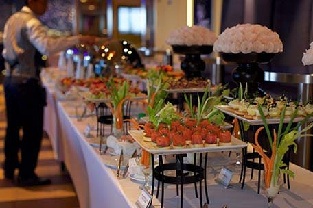 a server at a wedding buffet on a cruise