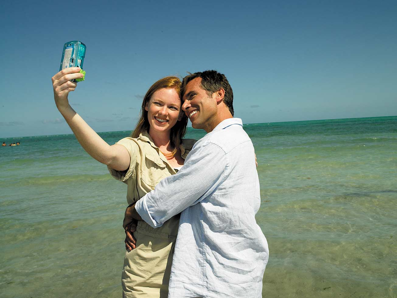 couple taking a selfie on the beach