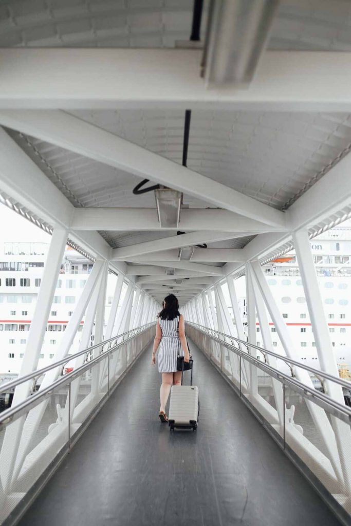 woman walking down cruise terminal