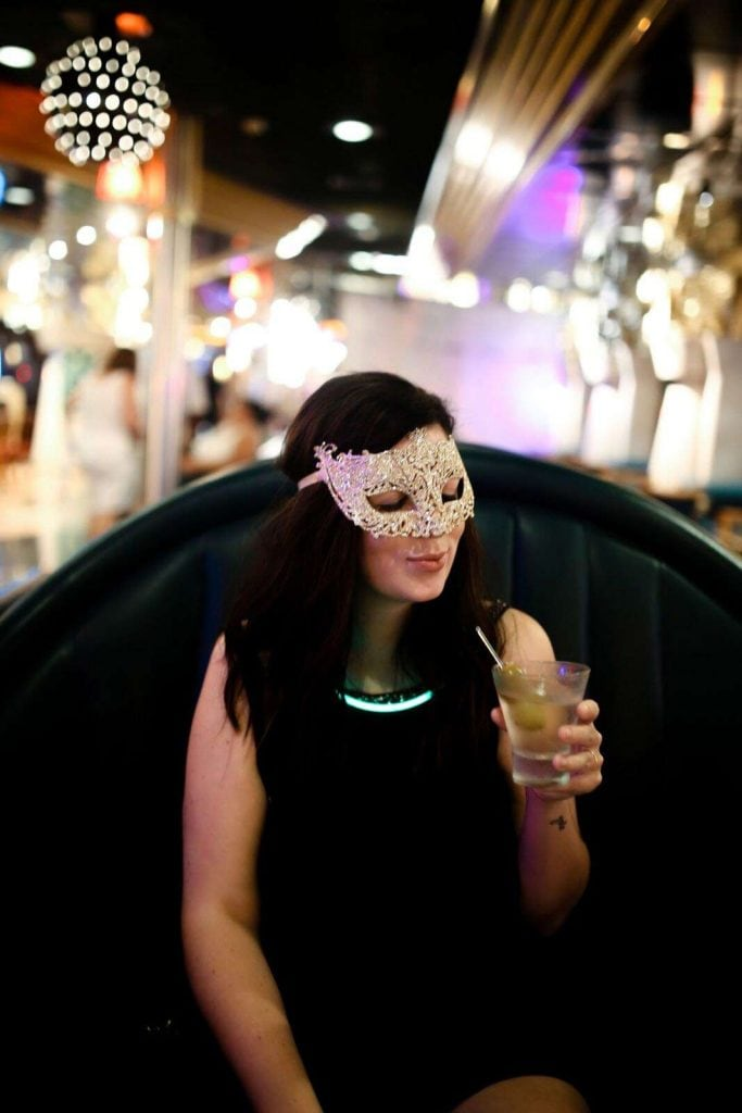 woman in mask with dessert