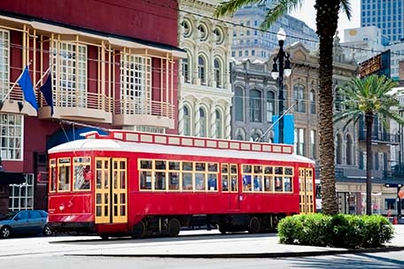 an iconic red streetcar in new orleans