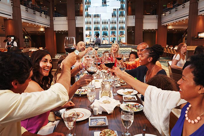 a group toasting during dinner on a carnival cruise