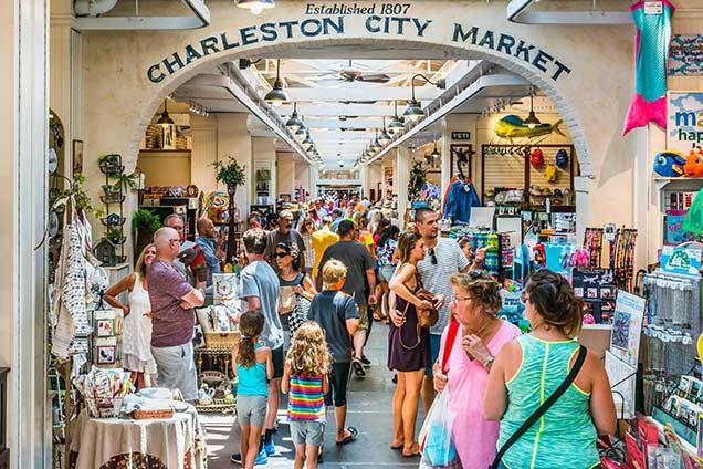 people shopping at the historic charleston city market