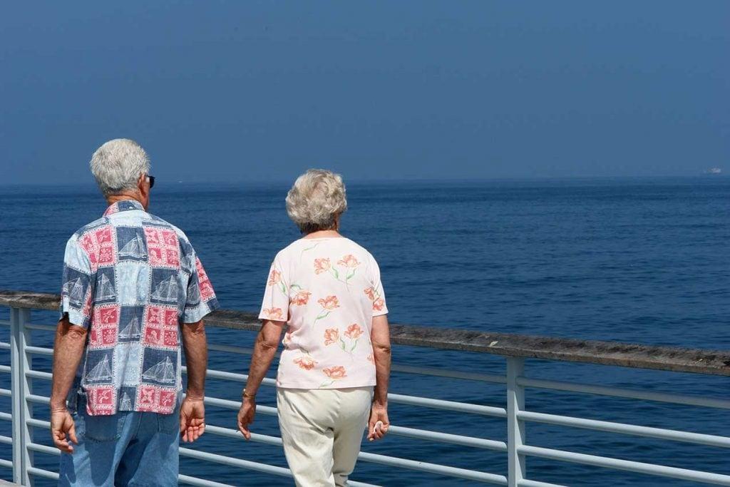 senior couple walking on cruise deck
