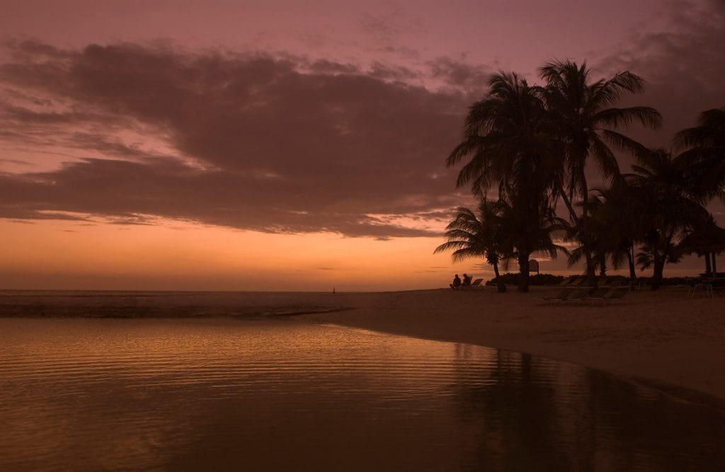 beach in aruba during sunset