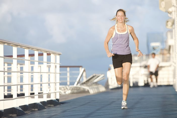 woman jogging on a track while on a carnival cruise
