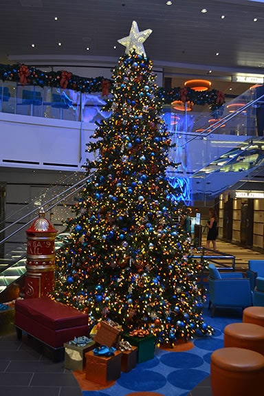 a christmas tree in the atrium of the carnival vista