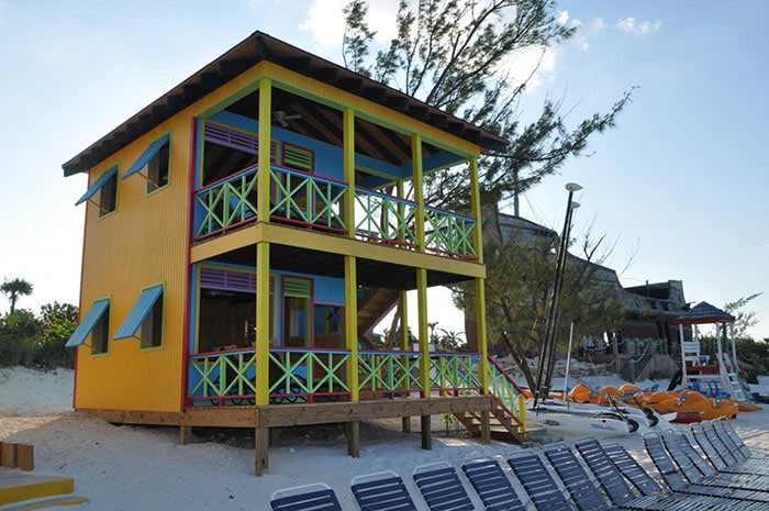 a yellow beach villa located in half moon cay, the bahamas