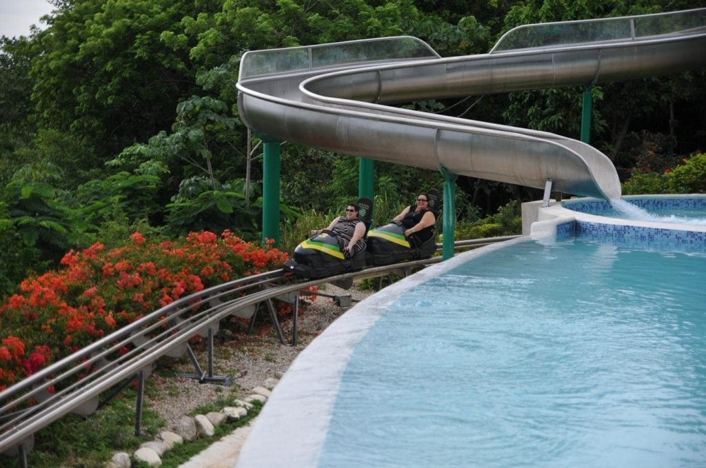 two women riding a bobsled as they go down mystic mountain